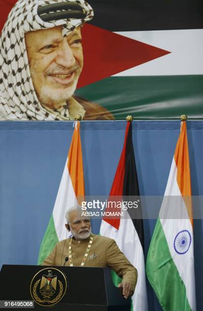 India's Prime Minister Narendra Modi addresses the media after his meeting with the Palestinian president under the watchful eyes of late Palestinian...