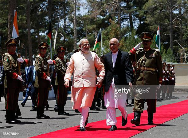 India's Prime Minister Narendra Modi and Afghan President Ashraf Ghani inspect the guard of honour in Herat on June 4, 2016. Indian Prime Minister...