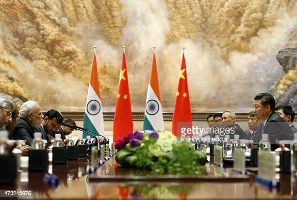 India's Prime Minister Narendra Modi and China's President Xi Jinping take part in a meeting in Xian in China's Shaanxi province on May 14 2015 Modi...