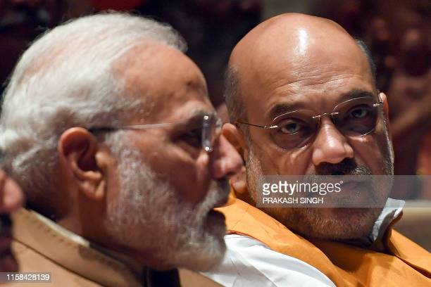 India's Prime Minister Narendra Modi and Home Minister Amit Shah attend a Bharatiya Janata Party parliamentary committee meeting at the Parliament...
