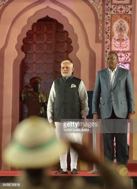 India's Prime minister Narendra Modi and Kenya's President Uhuru Kenyatta arrive to a meeting with members of the Indian community in Kenya during a...