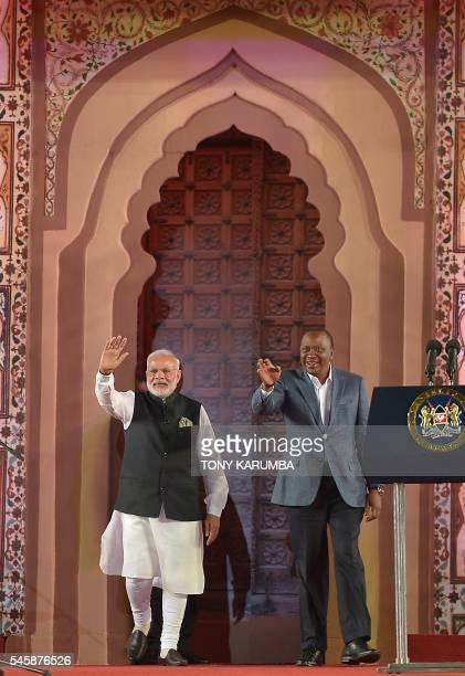 India's Prime minister Narendra Modi and Kenya's President Uhuru Kenyatta wave to members of the Indian community in Kenya during a meetthepeople...