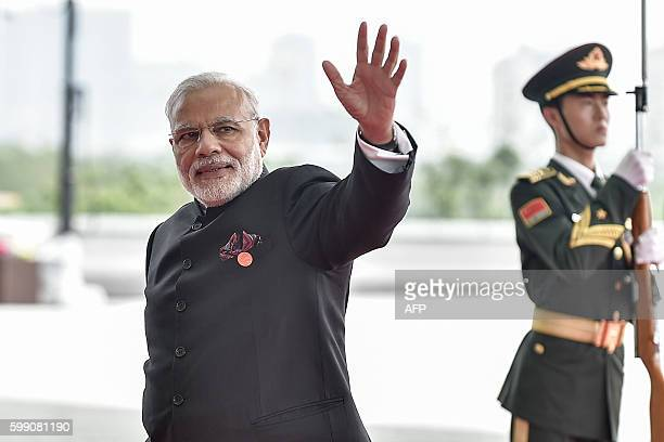 India's Prime Minister Narendra Modi arrives at the Hangzhou International Expo Center to attend the G20 Summit in Hangzhou on September 4, 2016....