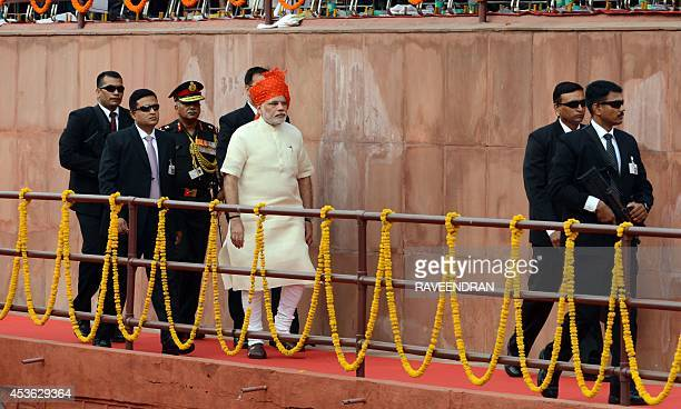 India's Prime Minister Narendra Modi arrives to deliver a speech from the ramparts of the Red Fort in New Delhi on August 15 to mark the country 68th...