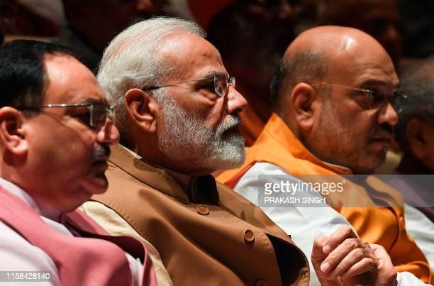 India's Prime Minister Narendra Modi , Bharatiya Janata Party working president Jagat Prakash Nadda and Home Minister Amit Shah attend a BJP...