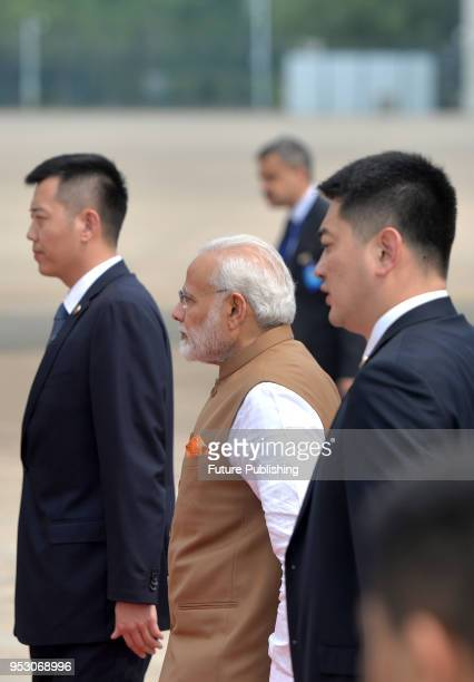 India's Prime Minister Narendra Modi center walks to his plane after the twoday informal summit with Chinese President Xi Jinping in Wuhan in central...