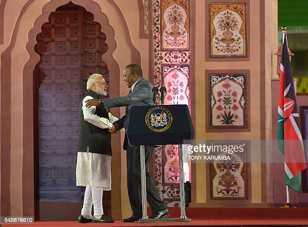 India's Prime minister Narendra Modi embraces Kenya's President Uhuru Kenyatta during a meetthepeople tour organsied for Modi in Nairobi on July 10...