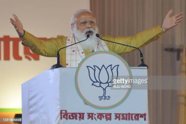India's Prime Minister Narendra Modi gestures as he addresses a public meeting ahead of Assam Assembly elections in Sipajhar on the outskirts of...