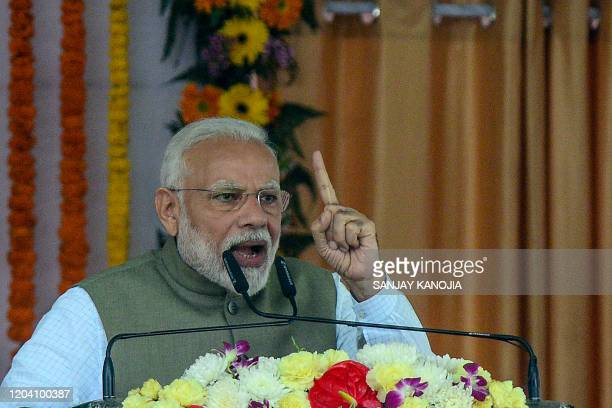 India's Prime Minister Narendra Modi gestures as he speaks during a function organised by the Indian government to distribute assistive aids and...
