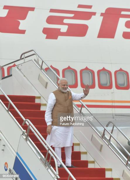 India's Prime Minister Narendra Modi gets onboard his plane after the twoday informal summit with Chinese President Xi Jinping in Wuhan in central...