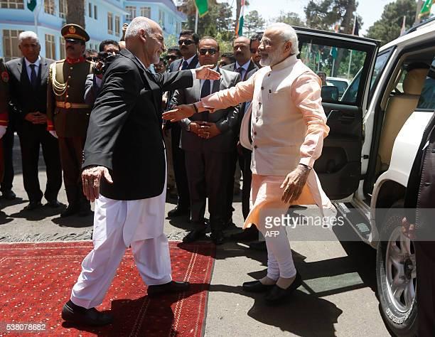 India's Prime Minister Narendra Modi greets Afghan President Ashraf Ghani before the inauguration of Salma Dam in Herat on June 4 2016 Indian Prime...
