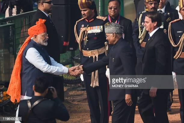 India's Prime Minister Narendra Modi greets President Ram Nath Kovind and Brazil's President Jair Bolsonaro as they arrive to attend the Republic Day...