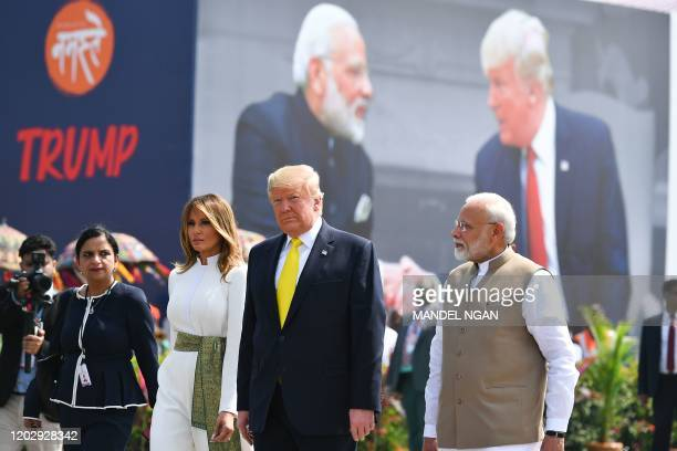 India's Prime Minister Narendra Modi greets US President Donald Trump and First Lady Melania Trump upon their arrival at Sardar Vallabhbhai Patel...