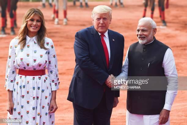 India's Prime Minister Narendra Modi greets US President Donald Trump and First Lady Melania Trump during a ceremonial reception at Rashtrapati...