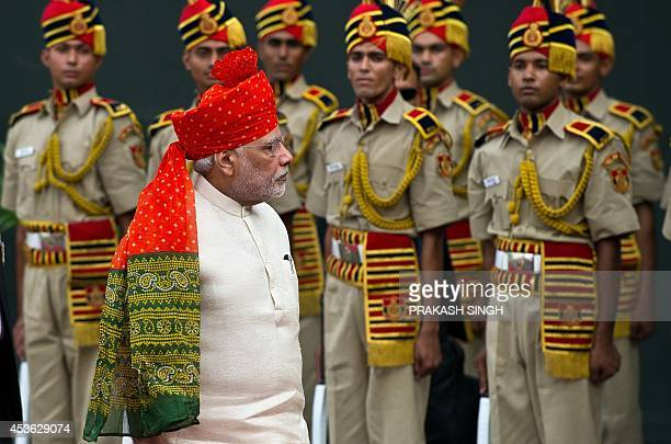 India's Prime Minister Narendra Modi inspects a guard of honour during the country's 68th Independence Day at the Red Fort in New Delhi on August 15...