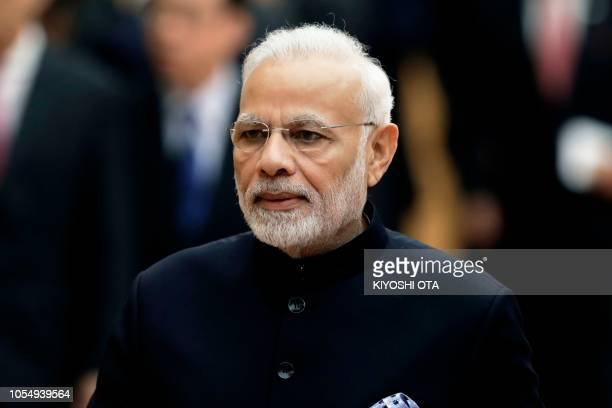 India's Prime Minister Narendra Modi looks on after reviewing an honour guard with Japan's Prime Minister Shinzo Abe ahead of a meeting at Abe's...