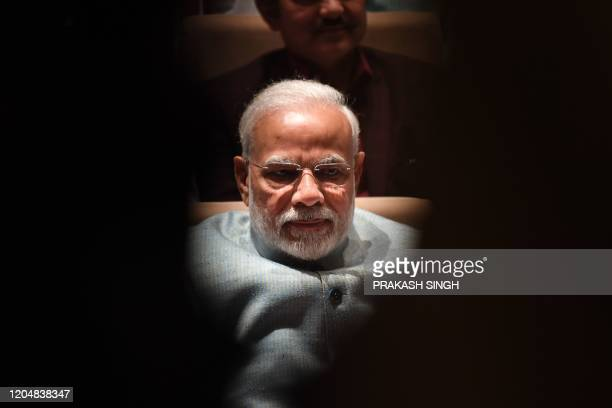 India's Prime Minister Narendra Modi participates in a Bharatiya Janata Party parliamentary committee meeting at the Parliament House in New Delhi on...