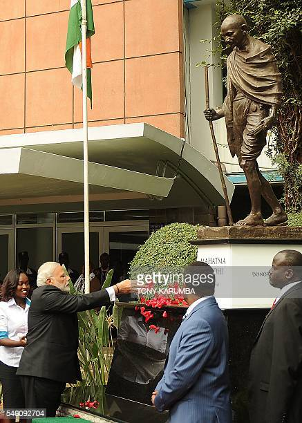 India's Prime Minister Narendra Modi pays homage at a statue of Mahatma Gandhi on July 11 2016 at the University of Nairobi Modi 66 and the 14th...