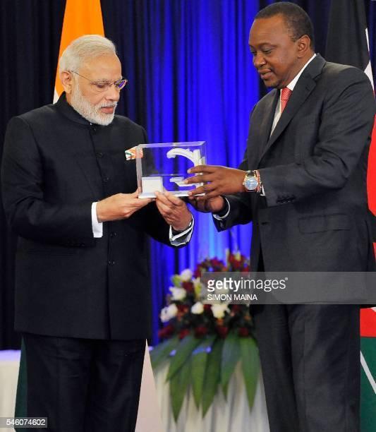 India's Prime minister Narendra Modi present to Kenya's President Uhuru Kenyatta a model of Bhabhatronfor cancer screening machine on July 11 2016 at...