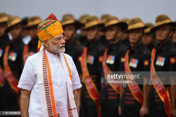 India's Prime Minister Narendra Modi reviews a guard of honour during a ceremony to celebrate country's 73rd Independence Day, which marks the of the...