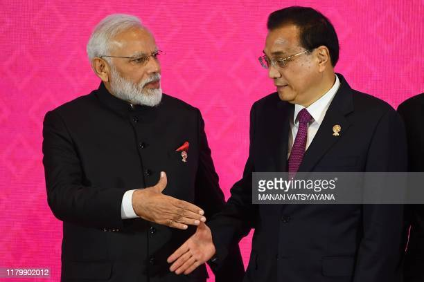 India's Prime Minister Narendra Modi shakes hands with China's Premier Li Keqiang during the 3rd Regional Comprehensive Economic Partnership Summit...