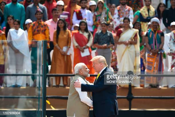 India's Prime Minister Narendra Modi shakes hands with US President Donald Trump during 'Namaste Trump' rally at Sardar Patel Stadium in Motera on...