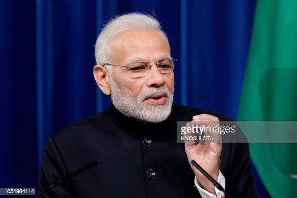 India's Prime Minister Narendra Modi speaks during a joint news conference with Japan's Prime Minister Shinzo Abe at Abe's official residence in...