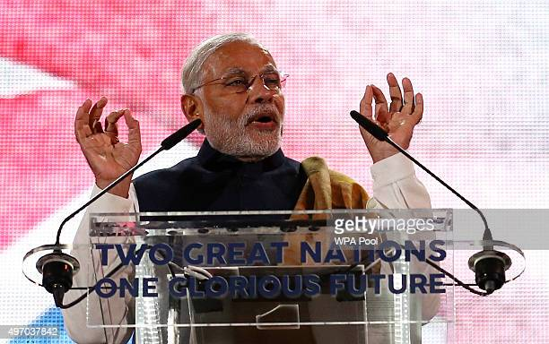 India's Prime Minister Narendra Modi speaks on stage at Wembley Stadium during a welcome rally on November 13 in London England In his first trip to...