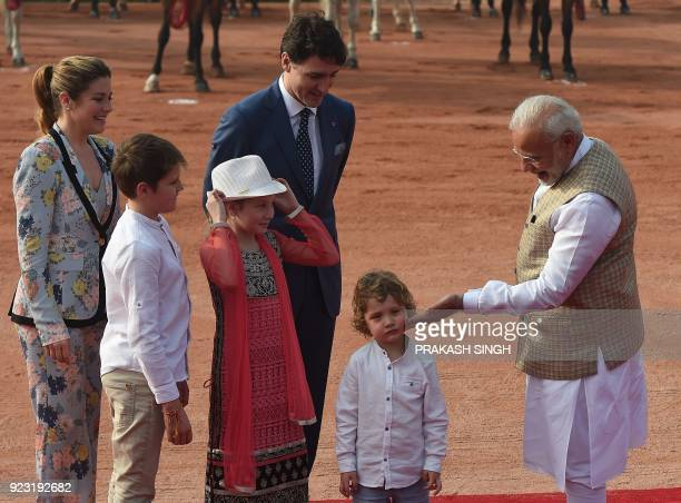 TOPSHOT India's Prime Minister Narendra Modi touches the cheek of Hadrien Trudeau the youngest son of Canada's Prime Minister Justin Trudeau and his...