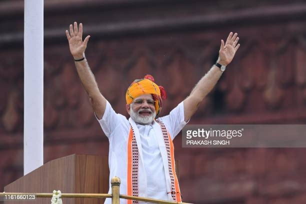 India's Prime Minister Narendra Modi waves at the crowd during a ceremony to celebrate country's 73rd Independence Day, which marks the of the end of...
