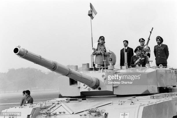 India's Prime Minister P V Narsimha Rao standing atop the newly launched Main Battle Tank , Arjun, developed and built in India along with military...