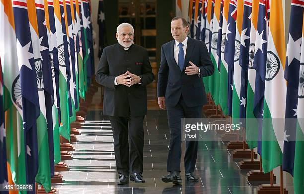 India's Prime Minster Narendra Modi and Australian Prime Minister Tony Abbott walk together as they leave the House of Representatives at Parliament...
