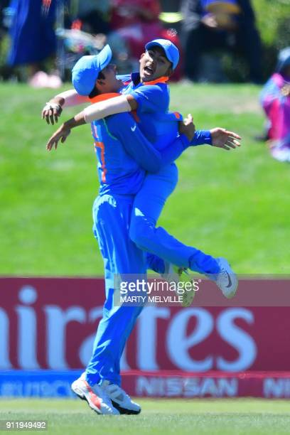 India's Prithvi Shaw celebrates catching Pakistan's Ali Zaryab with team mate Shubman Gill during the U19 semifinal cricket World Cup match between...
