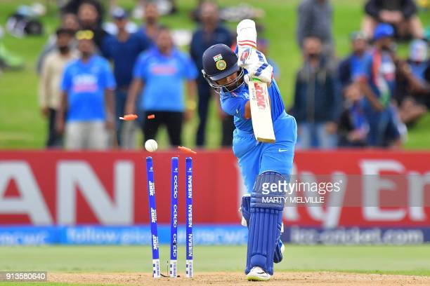 India's Prithvi Shaw is bowled during the U19 World Cup cricket final match between India and Australia at Bay Oval in Mount Maunganui on February 3...