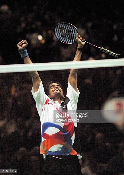 India's Pullela Gopichand reacts after winning match point during the final match against China's Chen Hong at the The Yonex All England Badminton...