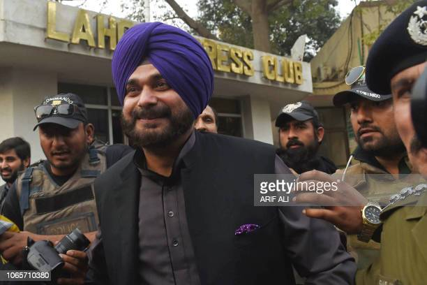 India's Punjab cabinet minister and former cricketer Navjot Singh Sidhu exits the Lahore Press Club after speaking to journalists in Lahore on...