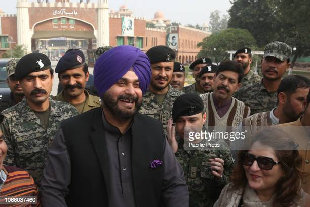 India's Punjab cabinet minister Navjot Singh Sidhu arrives at Pakistani border post Wagha and talking to media persons in Lahore Sidhu led his...