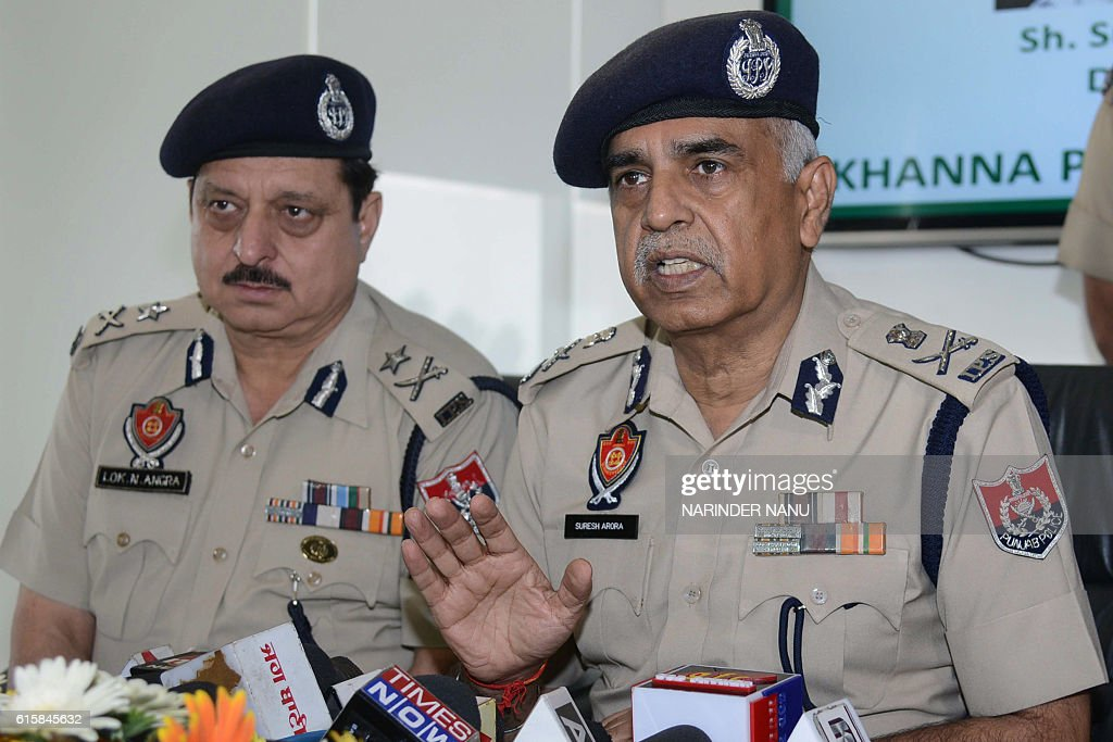 India`s Punjab police director general Suresh Arora addresses a press conference at a paper mill in Amritsar on October 20 where illegal drugs were...