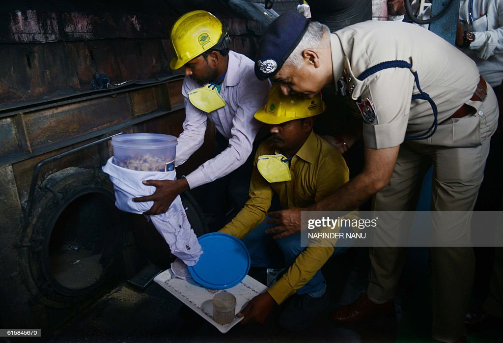 India`s Punjab police director general Suresh Arora overseas illegal drugs being destroyed at a paper mill in Amritsar on October 20 2016 Police said.
