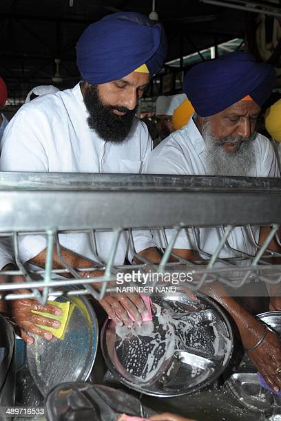 India's Punjab state Revenue Minister Bikram Singh Majithia , who was handed out punishment for distorting a Sikh hymn by incorporating Bharatiya...