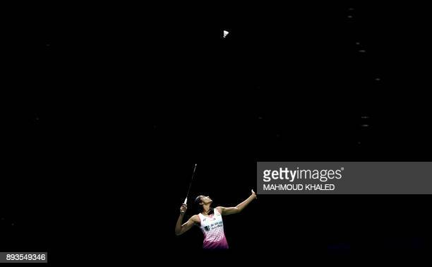India's Pusarla V Sindha returns the shot to Japan's Akane Yamaguchi during the third day of the Dubai Badminton World Superseries Finals in Dubai on...