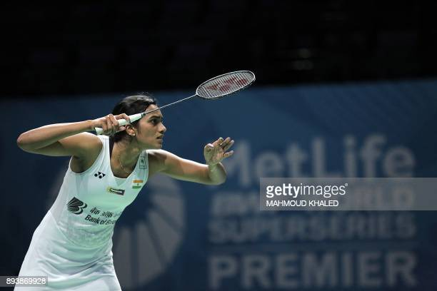 India's Pusarla V Sindhu reacts after returning a shot to China's Chen Yufei during their semifinal match during the Dubai Badminton World...