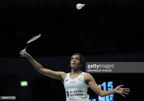 India's Pusarla V Sindhu returns a shot to China's Chen Yufei during their semifinal match during the Dubai Badminton World Superseries Finals in...