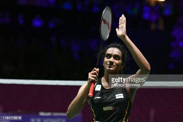 India's Pusarla Venkata Sindhu celebrates after winning against Japan's Nozomi Okuhara during their women's singles final match at the BWF Badminton...