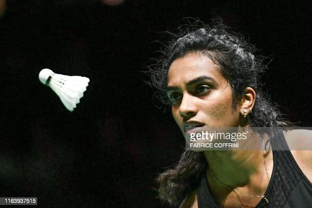 India's Pusarla Venkata Sindhu eyes the shuttlecock during her women's singles final match against Japan's Nozomi Okuhara at the BWF Badminton World...