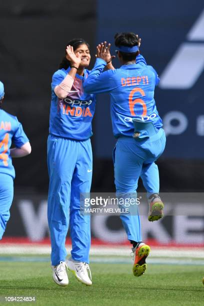 India's Radha Yadav celebrates with Deepti Sharma after taking the wicket of New Zealand's Suzie Bates during the first Twenty20 international...