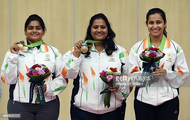 India's Rahi Jeevan Sarnobat Anisa Sayyed and Heena Sidhu pose with their bronze medals during the awards ceremony after the women's 25m pistol team...