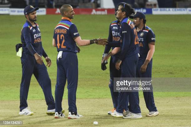 India's Rahul Chahar celebrates with his teammates after the dismissal of Sri Lanka's Dasun Shanaka during the third one-day international cricket...