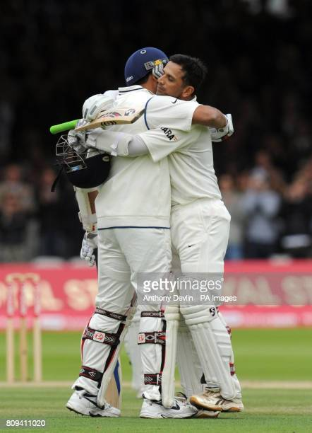 India's Rahul Dravid celebrates with Zaheer Khan after scoring 100 runs during day three of the First npower Test at Lord's Cricket Ground London