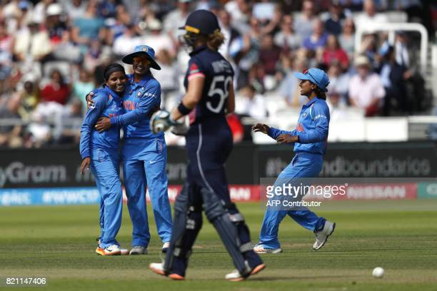India's Rajeshwari Gayakwad celebrates after taking the wicket of England's Lauren Winfield during the ICC Women's World Cup cricket final between...
